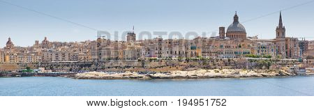 Stunning image of the Basilica Our Lady of Mount Carmel from Sliema. Location place ancient city Valletta, Malta island, sightseeing Europe. Popular tourist attraction. Beauty world.