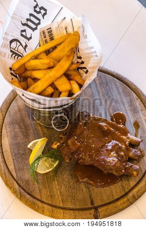 Pork Rib with Fries on wooden plate