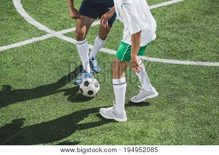 Partial View Of Athletic Soccer Players Playing Soccer On Pitch