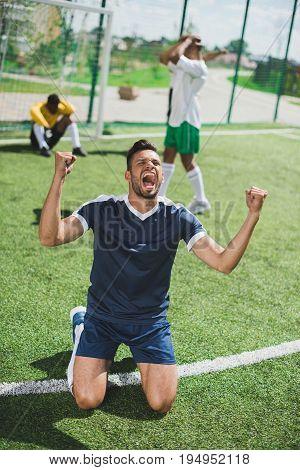 Happy Soccer Player Celebrating Goal During Soccer Match