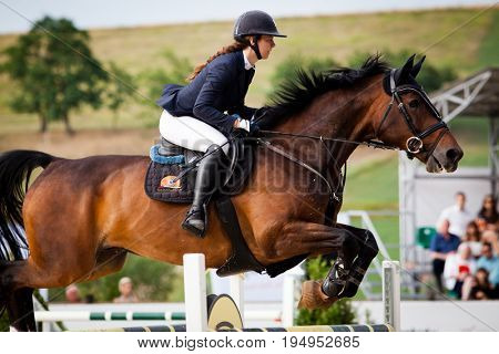 TURDA, CLUJ, ROMANIA - June 29, 2017: An unidentified competitor jumps with horse at the Salina Equines Horse Trophy , June 29, 2017 in Turda, Cluj, Romania