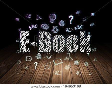 Learning concept: Glowing text E-Book,  Hand Drawn Education Icons in grunge dark room with Wooden Floor, black background