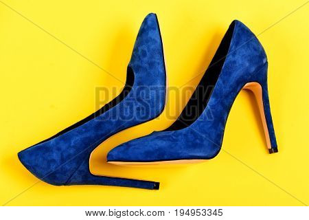 High Heel Footwear Isolated On Yellow Background. Shoes In Blue