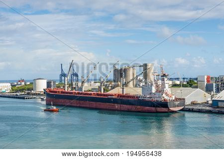 Port Louis Mauritius - December 25 2015: Bulk Carrier Ship JS Colorado in Port Louis Mauritius. Port Louis was already in use as a harbor in 1638.