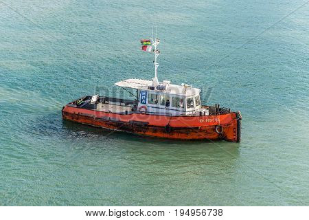 Port Louis Mauritius - December 25 2015: Tugboat Dombeya in Port Louis Mauritius. Port Louis was already in use as a harbor in 1638.