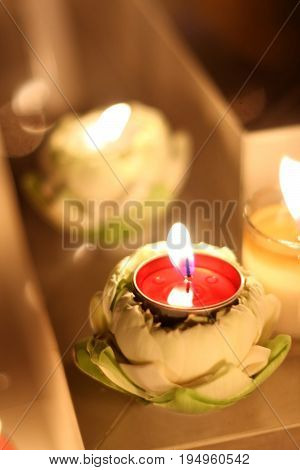 Burning Candle in lotus for sacrifice or decoration.