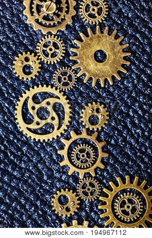 steampunk mechanical cogs gears wheels on leather background