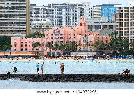 Honolulu Hawaii USA - May 28 2016: People enjoying the Hawaiian lifestyle in Waikiki