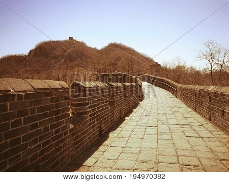 Hushan Great Wall of China (April, 2017), located on Tiger mountain, Dandong city, Liaoning province; beside China-North Korea border. It is the most eastern part of Great Wall. Vintage style photo. Copy space for adding text is on top and right-bottom.