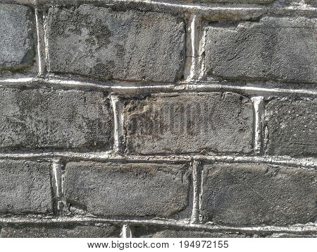 Texture of old blocks on cement wall in vintage style; untidy masonry; use uneven sizes of grey concrete bricks