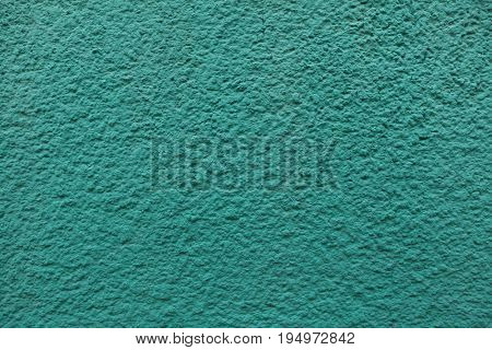 Emerald green painted stucco wall. Background texture.