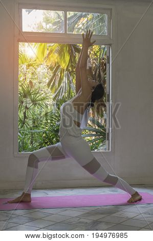 Young woman with clasped hands. Concept of calm and meditation. Yoga