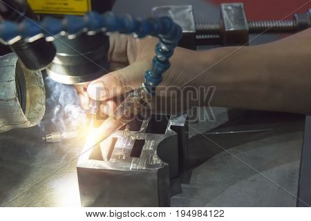 The specialist operator use the laser welding machine.The hi-precision welding process .