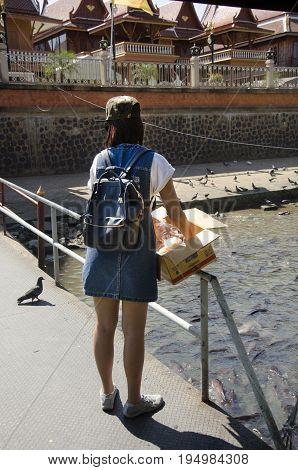 Asian Thai Girl People Feeding Food To Fish In Chao Phraya River