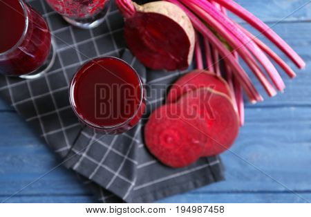 Antioxidant beet smoothies and sliced beetroot on wooden table