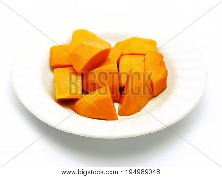 Cut papaya on white plate; white background. Deliciously sweet high fibre fruit; rich sources of antioxidant nutrients (carotenes, flavonoids, B and C vitamins, folate, minerals, etc.).