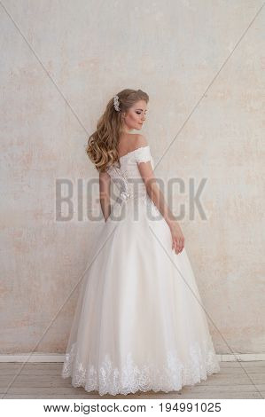 the bride at a wedding in white wedding dress 1