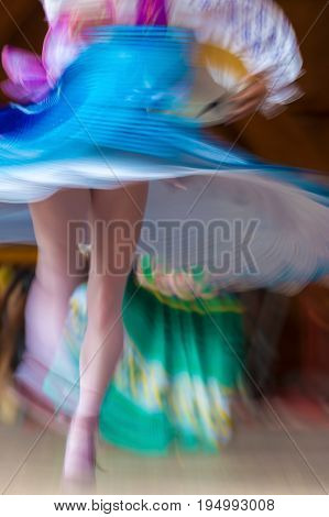Abstract motion of dancer girl in traditional folk dances.