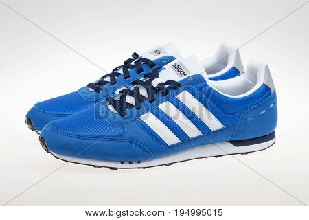 Varna Bulgaria - MARCH 12 2017 : ADIDAS V RACER sport shoe. Product shot. Adidas is a German corporation that designs and manufactures sports shoes clothing and accessories