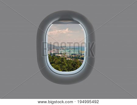 The island of Mahe in the plane window. Tropical Seychelles in airplane window
