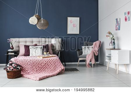 Thick pink blanket on the bed with soft bedheads
