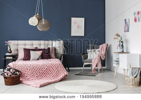 Small round white carpet on the floor in tidy stylish room