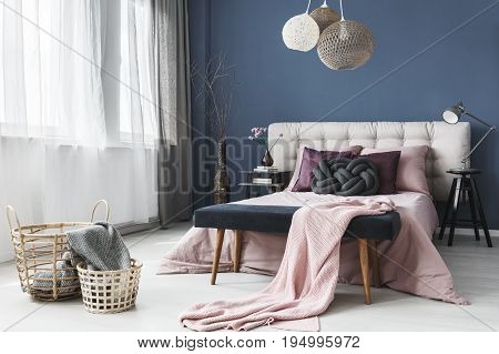 Spacious room in pastel colors with king-size bed and window