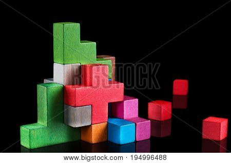 Abstract construction from wooden blocks tetris shapes. The concept of logical thinking geometric shapes.