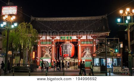 Tokyo Japan - May 2 2017: People are walking pass the red gate of Sensoji shrine.