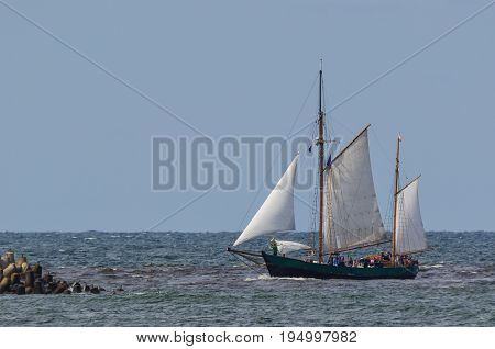 GAFF KETCH - Sailboat returns to port from the cruise