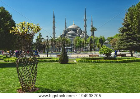 ISTANBUL, TURKEY - MAY 5, 2017: View of Sultan Ahmed Mosque, Blue Mosque, and fountain from the Sultanahmet Park in spring time in Istanbul, Turkey