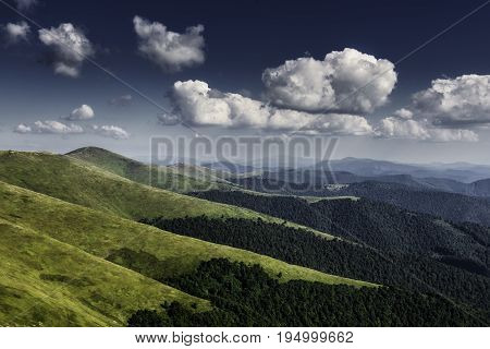 Autumn landscape. Autumn view of green Carpathian Mountains , top of the green hills on sunset landscape under blue cloudy sky