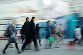 Group of people rushing to work at the morning in intentional motion blur. poster