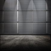 Classified room. Facility or Base type of grungy interior, with vented metal walls and concrete floor. poster