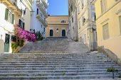 Typical street in old town of Kerkyra Corfu town with stairs and blooming bougainvillea on the island Corfu Greece. poster