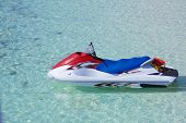 Personal watercraft on crystal blue water poster