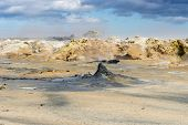 The area has a lot of geothermal energy which shows itself in the form of bubbling pools of grey mud and sulphur poster