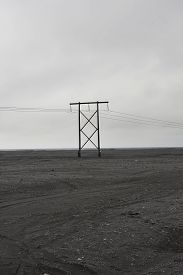 Telephone line in the middle of a field of volcanic rock, photographed in Iceland