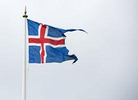 Iceland flag against an overcast cloudy sky