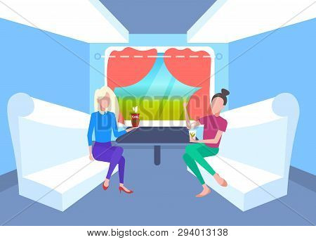 Two Women Sitting Together In Train Compartment Passengers Discussing Drinking Tea During Vacation T