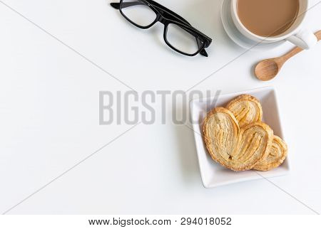 Cup Of Coffee With Snacks On Desk Office With Copy Space, Top View