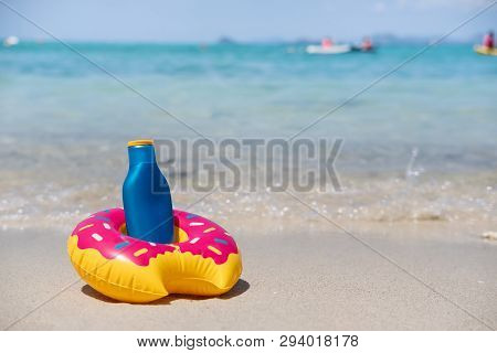 Sunscreen On White Sandy Tropical Beach, Summer Vacation And Travel Concept