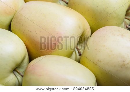Raw Delicious Apples Golden With Skin Background