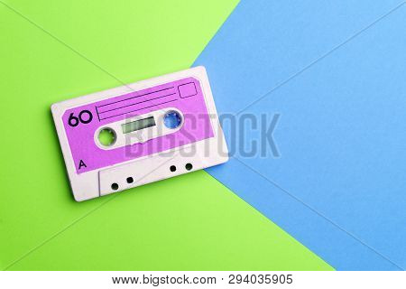 Retro Old School 80-s Or 90-s Concept. Audio Cassette On A Bright Blue-pink Background