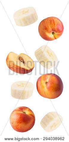 Falling Fresh Peaches And Banana Isolated On White Background