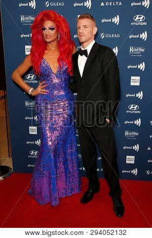 LOS ANGELES - MAR 28:  Rhea Litre?, Daniel Newman at the 30th Annual GLAAD Media Awards at the Beverly Hilton Hotel on March 28, 2019 in Los Angeles, CA