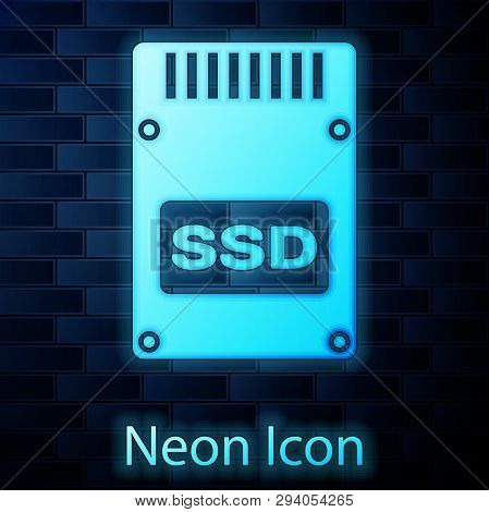Glowing neon SSD card icon isolated on brick wall background. Solid state drive sign. Storage disk symbol. Vector Illustration poster