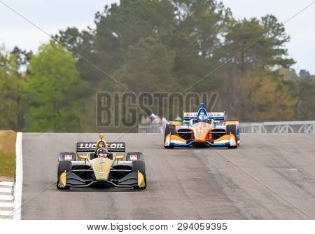 April 05, 2019 - Birmingham, Alabama, USA: MARCUS ERICSSON (R) (7) of Sweden  goes through the turns during practice for the Honda Indy Grand Prix of Alabama at Barber Motorsports Park in Birmingham,