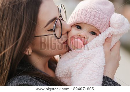 Portrait Of Mother And Her Little Baby Girl. Beautiful Mom And Cute Baby. Mother Hud Her Daughter. B