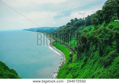 Top View Of The Sea Coast With Rail Tracks From The Observation Platform Of The Botanical Garden Of